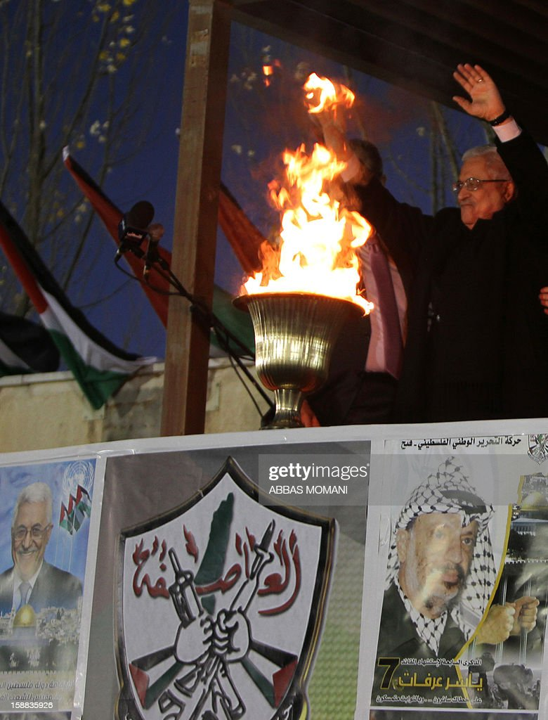 Palestinian President Mahmud Abbas waves to thousands of Palestinians on the eve of the 48th anniversary of the formation on the Fatah movement, on December 31, 2012, in the West Bank city of Ramallah. The Fatah anniversary commemorates the first operation against Israel claimed by its armed wing then known as Al-Assifa (The Thunderstorm in Arabic) on January 1, 1965.