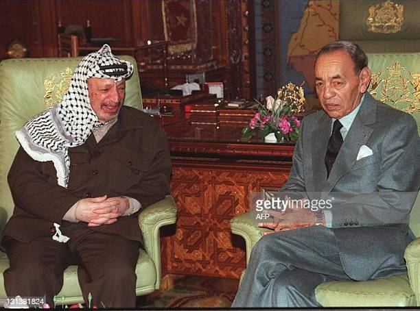Palestinian President Yasser Arafat chats with King Hassan II at the Royal Palace in Rabat 24 January Arafat is here for a short stay in Morocco on...