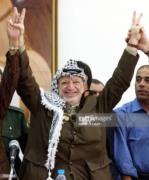 Palestinian President Yasser Arafat Salutes Supporters In Ramallah