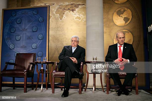 Palestinian Prime Minister Mahmoud Abbas and Israel's Prime Minister Ehud Olmert listen as US President George W Bush speaks at a Middle East peace...