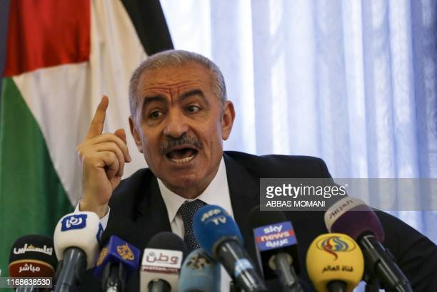 Palestinian Prime Minister Mohammad Ashtiyeh speaks to the press in the Israelioccupied West Bank village of Fasayel in the Jordan Valley on...