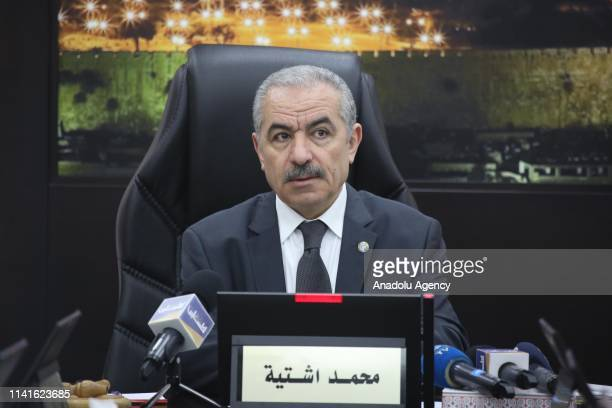 Palestinian Prime Minister Mohammad Shtayyeh makes a speech as he leads the weekly cabinet meeting at the Prime Ministry building in Ramallah West...