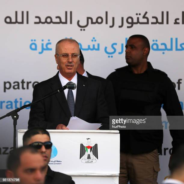 Palestinian Prime Minister Rami Hamdallah delivers a speech during opening of the desalination plant after he escaped unhurt an explosion struck near...