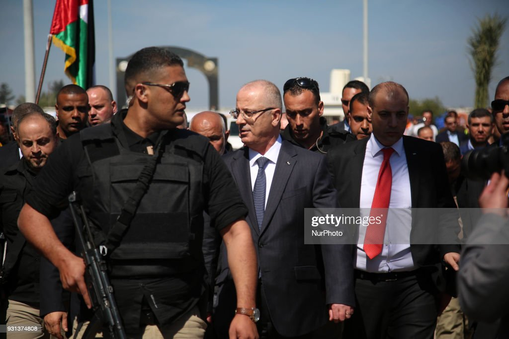 Palestinian Prime Minister Rami Hamdallah (2nd-R), escorted by his bodyguards, is greeted by police forces of the Islamist Hamas movement (L) upon his arrival in Gaza City on March 13, 2018