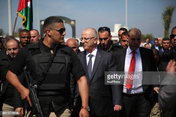 Palestinian Prime Minister Rami Hamdallah escorted by his bodyguards is greeted by police forces of the Islamist Hamas movement upon his arrival in...