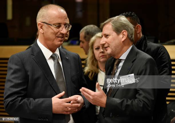 Palestinian prime minister Rami Hamdallah talks with EU commissioner for Neighbourhood policy and enlargement Johannes Hahn prior to an extraordinary...