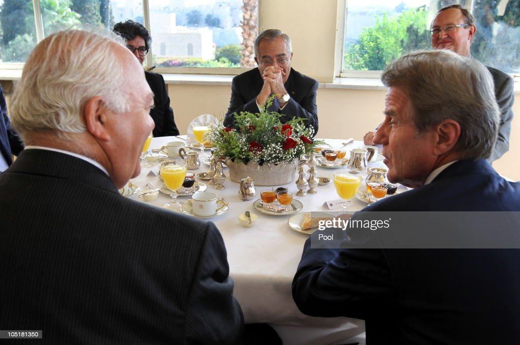 Palestinian Prime Minister Salem Fayyad (C) with Bernard Kouchner (R), French Minister of Foreign and European Affairs, and Spanish Foreign Minister Miguel Angel Moratinos during a breakfast meeting in the French Consulate on October 11, 2010 in Jerusalem, Israel. European diplomats are attempting to get the Israeli - Palestinian direct talks back on track.