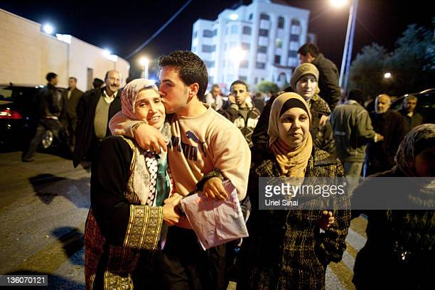 A Palestinian prisoner celebrates during his release on December 18 2011 in Ramallah West Bank Israel released 550 Palestinian prisoners to complete...