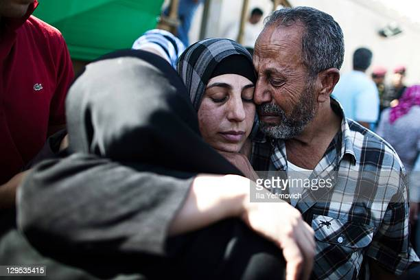 Palestinian prisoner hugs relatives after arriving in Mukata following her release on October 18 2011 in Ramallah West Bank Israeli Defense Forces...