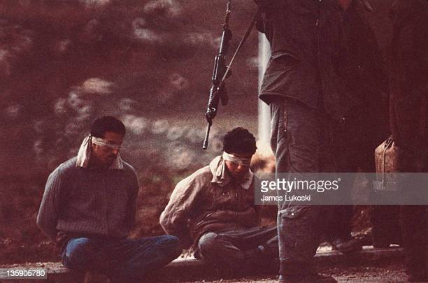 Palestinian prisoners being taken in for questioning in the West Bank during the IsraeliPalestinian conflict 1989
