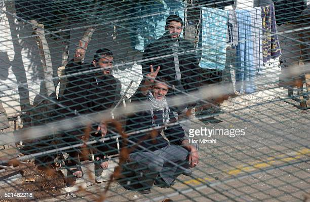Palestinian prisoners convicted of security offenses against Israel are seen at the courtyard in Megido jail northern Israel February 15 2005...