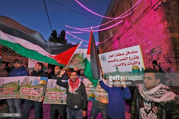 Palestinian protest against the USproposed peace plan following Friday morning prayers at a religious site known to Muslims as the Ibrahimi Mosque...