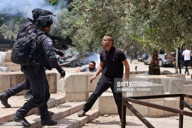 Palestinian protester argues with Israeli security forces in Jerusalem's Old City on May 10 as a planned march marking Israel's 1967 takeover of the...
