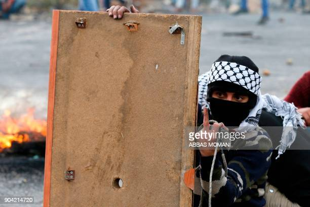 A Palestinian protester gives the middle finger during clashes with Israeli forces on January 12 2018 north of Ramallah in the Israelioccupied West...