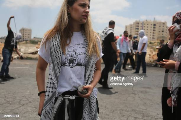 Palestinian protester holds a stone during a protest organized to mark 70th anniversary of Nakba also known as Day of the Catastrophe in 1948 and...