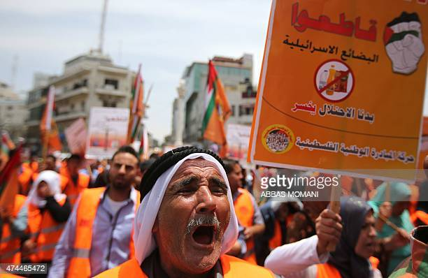 A Palestinian protester shouts slogans during a demonstration in the West Bank city of Ramallah calling for the boycott of all Israeli made products...