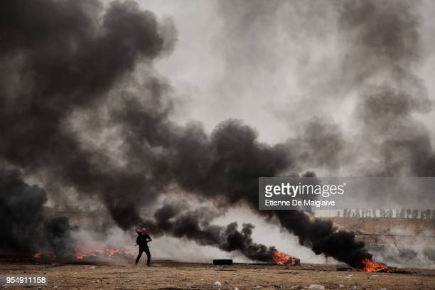 Palestinian protester sling shoots a rock toward Israeli forces on May 4, 2018 in Khan Yunis, Gaza. Israeli troops fired live rounds and tear gas at...