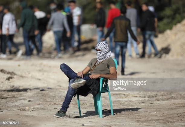 A Palestinian protester take a break during a demonstration against US President Donald Trump's recognition of Jerusalem as Israel's capital in the...