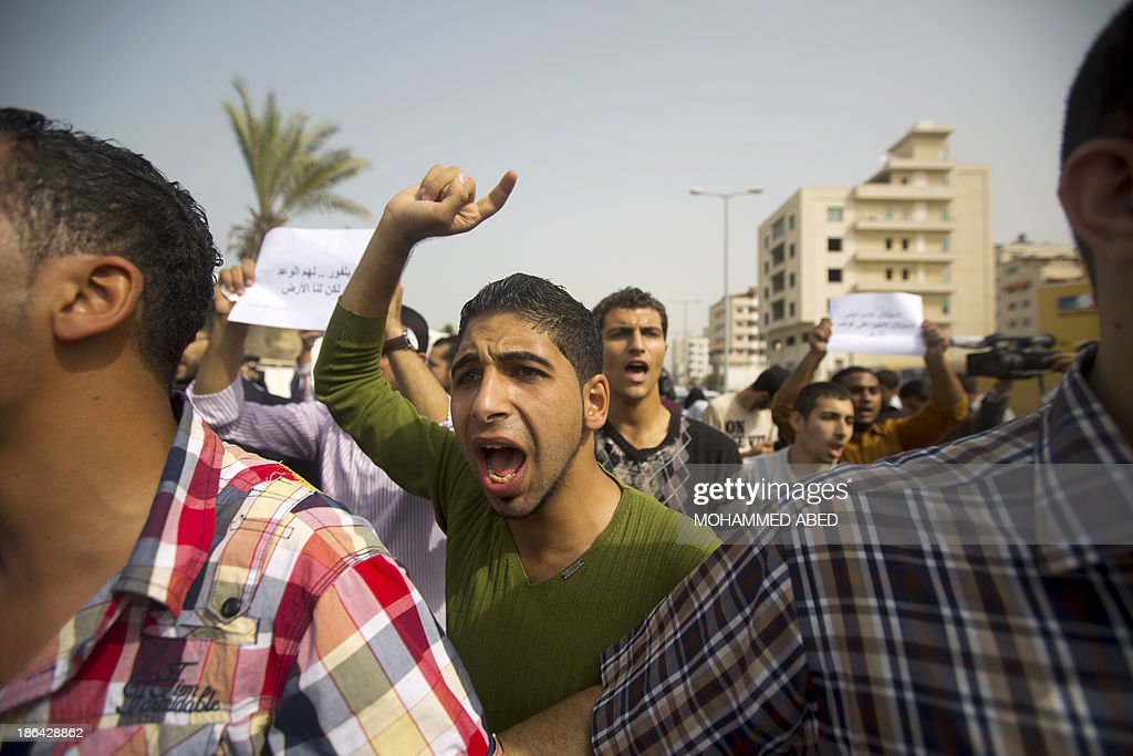 A Palestinian protester takes part in a demonstration in Gaza City to mark the anniversary of the Balfour Declaration on October 31, 2013. The 1917 Balfour Declaration is a formal statement of policy by the British government regarding the establishment of a Jewish homeland in Palestine.