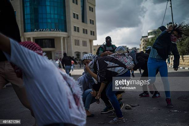 Palestinian protester throw rocks during clashes with IDF and Israeli Border Police on October 8 2015 in BeitEl WestBank As Tension rises between...