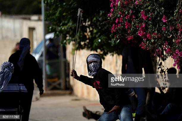 A Palestinian protester throws stones at Israeli forces during clashes with Israeli soldiers over the Jewish settlement of Qadomem at Kofr Qadom...