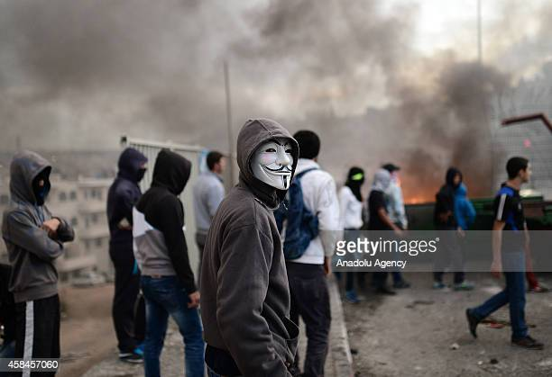 Palestinian protester wearing anonymous V For Vendetta Guy Fawkes mask during the clashes with Israeli police at Shuafat refugee camp after a...