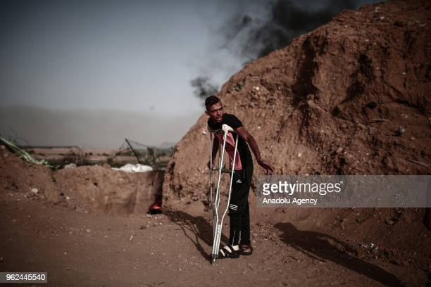 Palestinian protester with crutches attends a demonstration within the Great March of Return near Al Bureij Refugee Camp on the GazaIsrael border in...