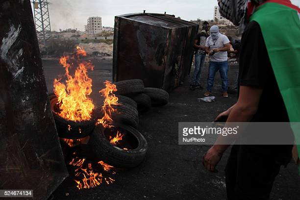 Palestinian protesters behind trash container and fire of tires during clashes with Israeli troops near Ramallah city west bank Clashes erupted...