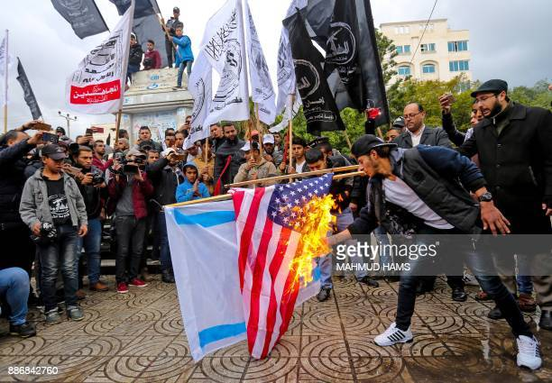 Palestinian protesters burn the US and Israeli flags in Gaza City on December 6 2017 President Donald Trump is set to recognise Jerusalem as Israel's...