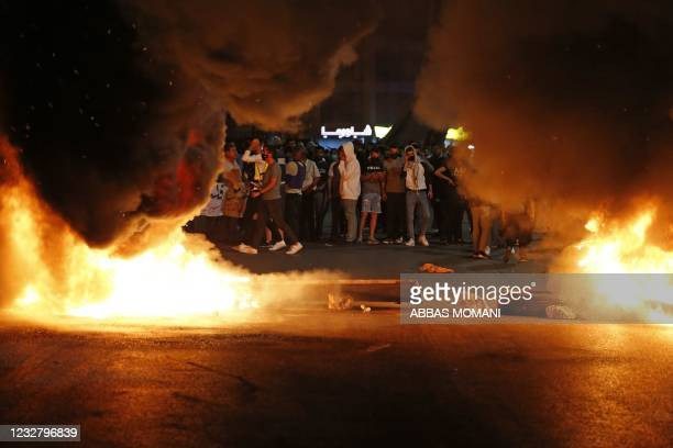 Palestinian protesters burn tires during an anti-Israel demonstration over tension in Jerusalem, near the Jewish settlement of Beit El near Ramallah,...