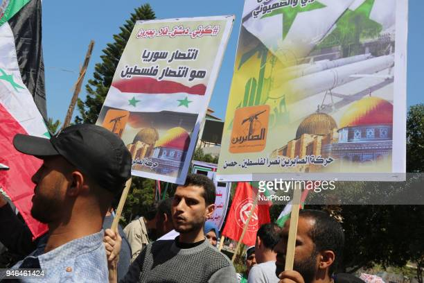 Palestinian protesters chant slogans and wave the flags of Palestine Syria and Iran during a demonstration against strikes carried out by the United...