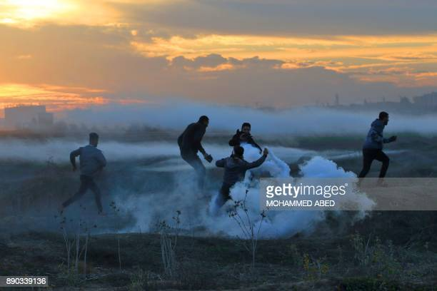 TOPSHOT Palestinian protesters clash with Israeli forces on December 11 2017 near the border fence with Israel east of Gaza City Protests flare in...