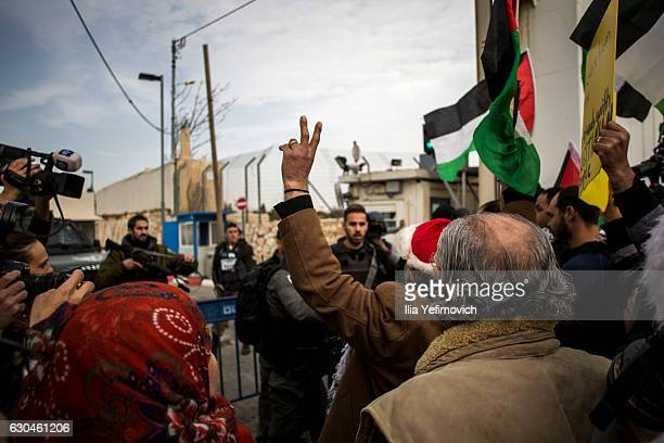 Palestinian protesters clash with Israeli security forces at the Israeli separation barrier on December 23 2016 in Bethlehem West Bank Ahead of...
