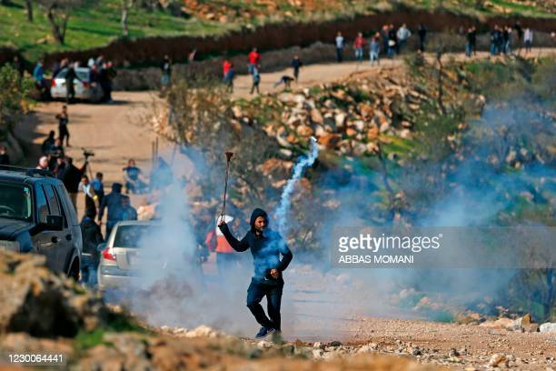 Palestinian protesters clash with Israeli security forces following a rally in the village of Mughayir, north of the West Bank city of Ramallah, on...