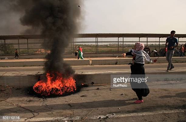 Palestinian protesters clash with Israeli security forces next to the border fence with Israel on October 23 2015 at the Erez crossing in the...