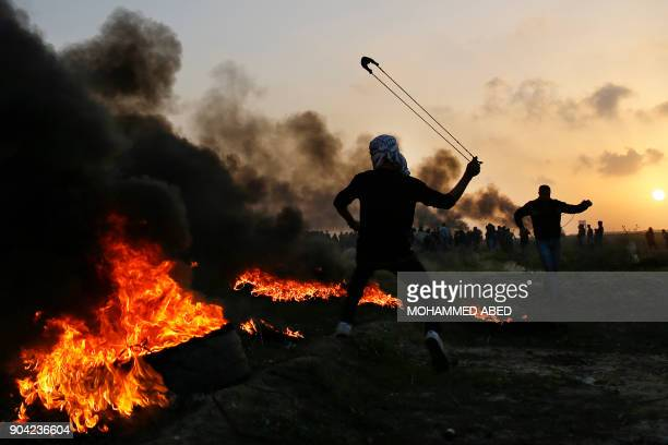 TOPSHOT Palestinian protesters clash with Israeli security forces on the eastern outskirts of Gaza City near the border with Israel on January 12...