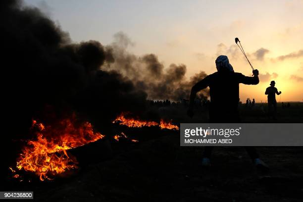 Palestinian protesters clash with Israeli security forces on the eastern outskirts of Gaza City near the border with Israel on January 12 2018 / AFP...