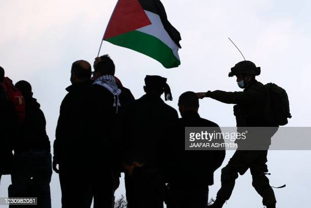 Palestinian protesters confront Israeli security forces during a demonstration against the expansion of settlements near the village of Beit Dajan,...