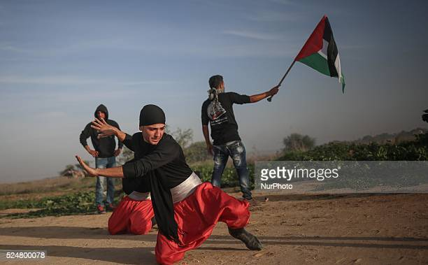Palestinian protesters dance the traditional quotDabkequot during clashes with Israeli security forces along the border with Israel on the eastern...