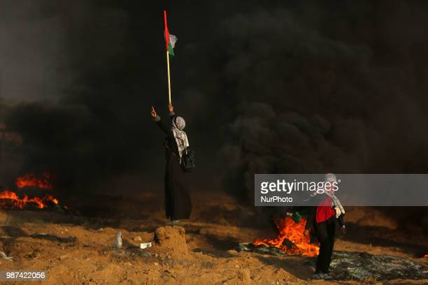 Palestinian protesters demonstrate as they confront Israeli forces along the border between the Gaza strip and Israel, east of Gaza city on June 29,...