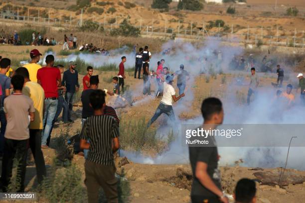 Palestinian protesters during clashes with following a demonstration along the border with Israel east of Bureij in the central Gaza Strip on...