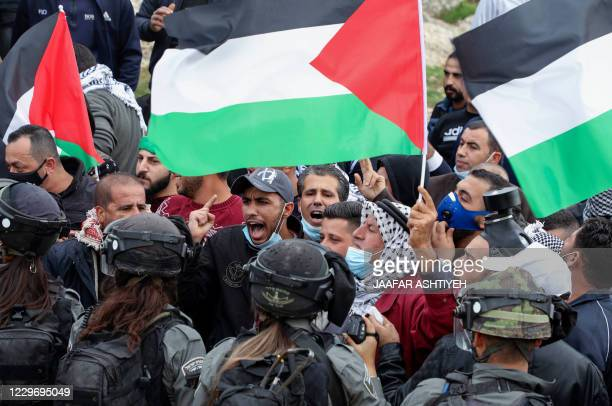 Palestinian protesters faceoff with Israeli security forces following a demonstration against the expansion of settlements near the village of Beit...