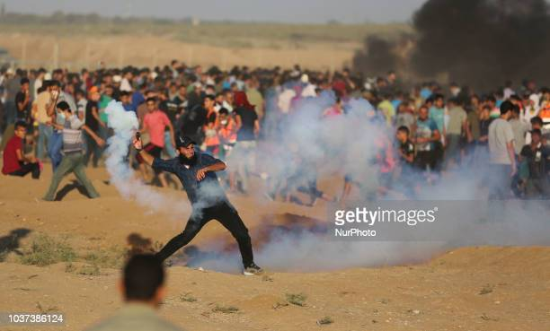Palestinian protesters gather during a demonstration along the Israeli border fence east of Gaza City on September 21 2018