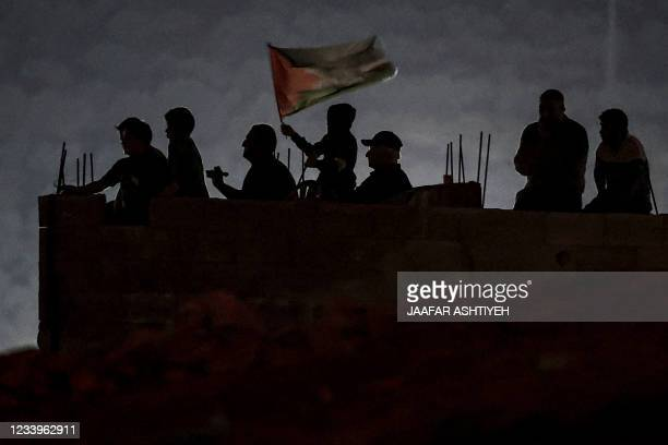 Palestinian protesters gather for a demonstration against the Israeli settlers' outpost of Eviatar, in the town of Beita, near the occupied West Bank...