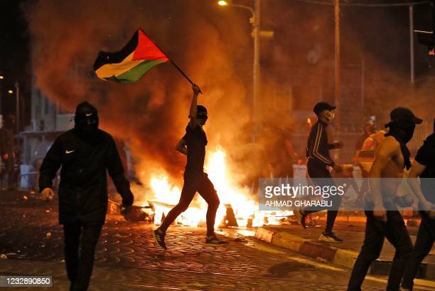 Palestinian protesters hurl stones during clashes with Israeli forces in the Shuafat Palestinian neighbourhood, neighbouring the Israeli settlement...