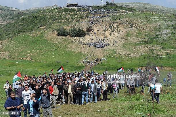 Palestinian protesters infiltrate the IsraelSyria border on May 15 2011 near the Druze village of Majdal Shams Israel Reportedly at least twelve were...