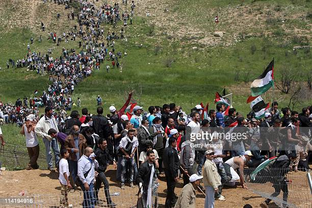 Palestinian protesters infiltrate the Israel-Syria border on May 15, 2011 near the Druze village of Majdal Shams, Israel. Reportedly at least twelve...