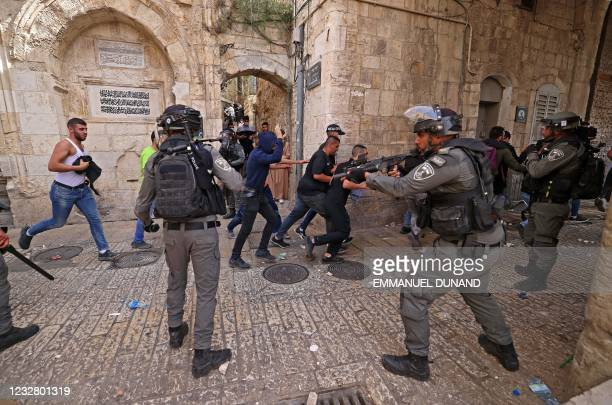 Palestinian protesters run from Israeli security forces amid clashes in Jerusalem's Old City on May 10 ahead of a planned march to commemorate...