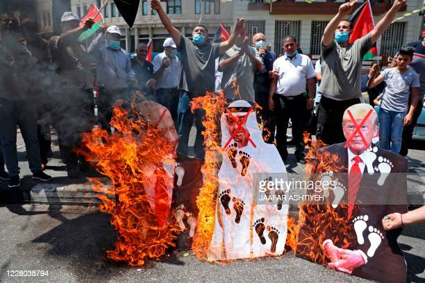 Palestinian protesters set aflame cut-outs showing the faces of Israeli Prime Minister Benjamin Netanyahu, Abu Dhabi Crown Prince Sheikh Mohammed bin...