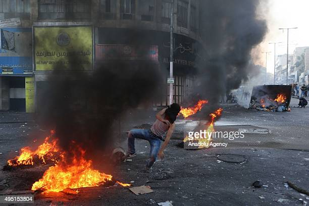 Palestinian protesters set tyres up on fire during the clashes with Israeli forces following a demonstration against Israeli Government's violations...